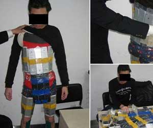 عجائب: مهرب صيني يحاول تهريب 94 أيفون بربطها حول جسده