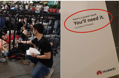 قامت هواوي بتوزيع شواحن متنقلة على الناس خارج متاجر آبل في مشهد ساخر (ستغافورة)